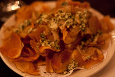 chips topped with blue cheese and sauteed onion