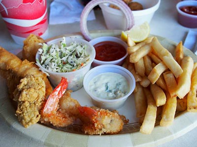 seafood plate: oysters, fish, shrimp, cole slaw