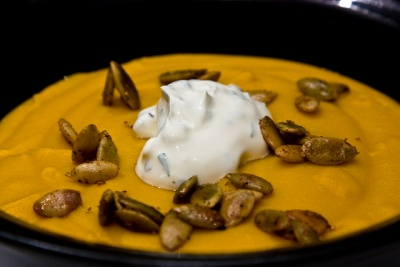 pumpkin soup with spiced pumpkin seeds and herbed creme fraiche