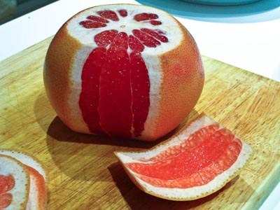 cutting skin from grapefruit
